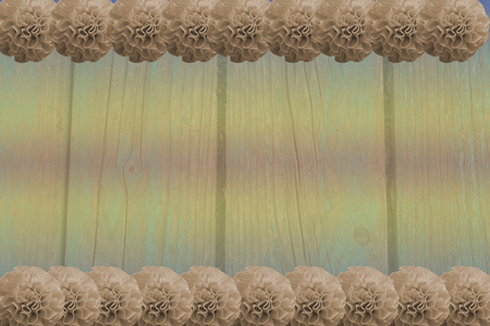 pale wooden background with beige pompoms Stock Photo