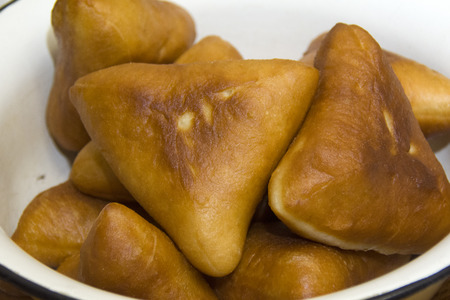 many tatar pies ina bowl, with meat filling Stock Photo