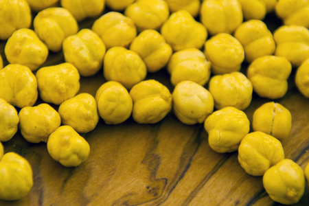 yellow roasted chick-peas on the wooden background
