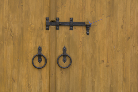 metal lock and vintage circles on the wooden door