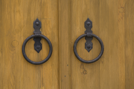 vintage metal circles on the wooden door