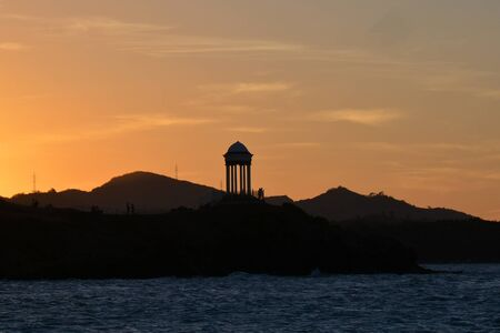 hills on the coast of Dominican republic, with antennas, at the sunset