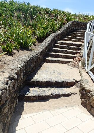 stone stairs with wooden bailing at the hill, by the sea Banque d'images
