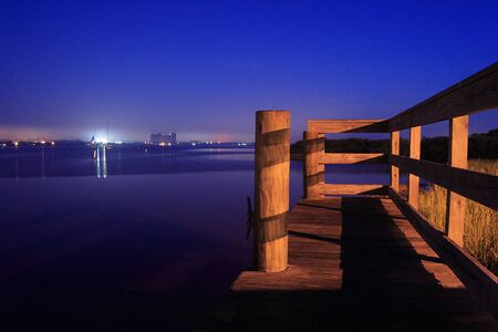 Fishing Docks on the river overlooking city at dawn photo