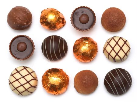 chocolates: Mixed Chocolates, milk and dark, against a white background