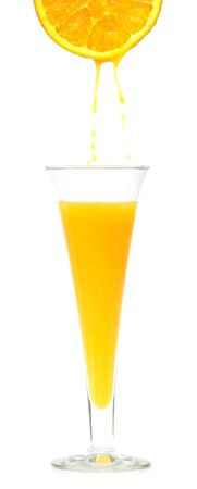 A glass of freshly squeezed orange juice photo