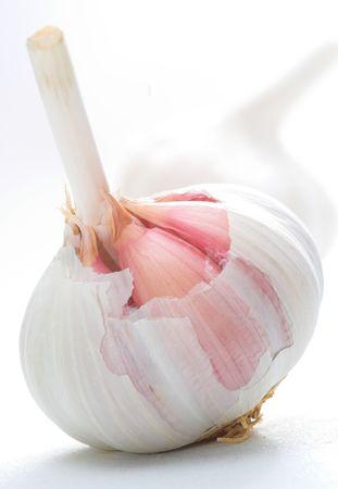 fresh garlic: Bulbs of organic garlic, partly peeled Stock Photo
