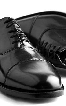 Black leather shoes against a white background Stock Photo - 942825