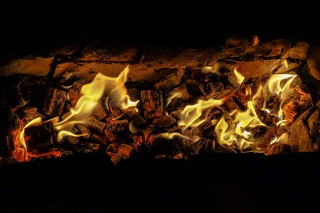 lurid: Fire. Charcoal burning in the furnace.