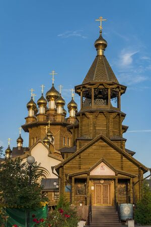 Golden domes of Russian Orthodox wooden church.