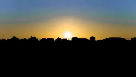 suburbian: Evening sunset over the suburbian roofs. Dark skyline in the backlighting. Image with copy space.
