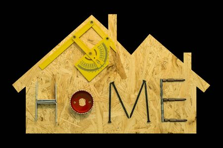 gable home renovation: Home repair concept. Fixing materials and tools on a sheet of OSB in the form of home. Isolated objects on a black background.