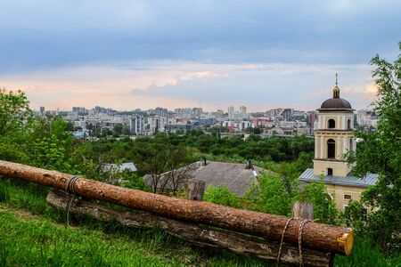 relievo: Belgorod city. Russia. View of the central part of the Belgorod region in the train station road. View from the St. Michael Church (1844 year of construction). City in fresh green plants. Stock Photo