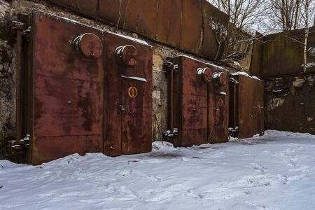cold storage: Nuclear bunker. Nuclear bomb shelter. Old abandoned Soviet Cold War bunker in forest. Nuclear bunker of Soviet Union, intended for storage of military equipment and personnel during a nuclear attack.