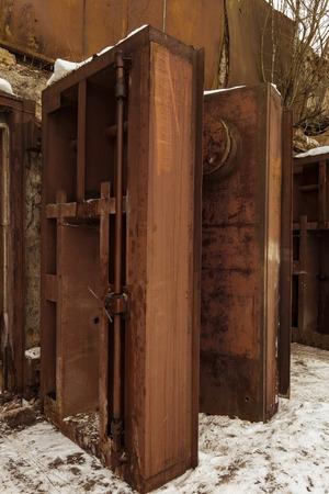 cold war: Nuclear bunker. Nuclear bomb shelter. Old abandoned Soviet Cold War bunker in forest. Upcoming reinforced steel hopper gates.