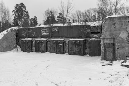 nuclear bomb: Nuclear bunker. Nuclear bomb shelter. Old abandoned Soviet Cold War bunker in forest. Nuclear bunker of Soviet Union, intended for storage of military equipment and personnel during a nuclear attack.