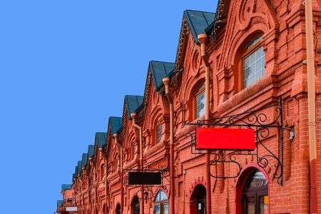 the 19th century: Vintage shopping arcade - architecture background. Exterior architecture of old shopping arcades of the 19th century. Russian stone architecture of the 19th century. Old brick building. Stock Photo