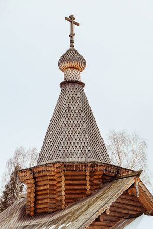 Woden dome of Russian Orthodox church. Wooden church. Church with wooden cross and dome.