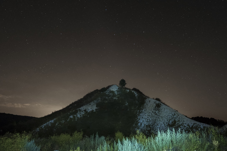 chalky: Summer night sky over the white chalky mountain, hill. Starry night landscape. Night background. Stock Photo