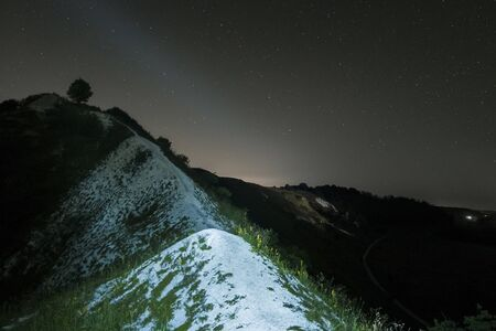 chalky: Summer night sky over the white chalky mountains, hills. Starry night landscape. Night background. Stock Photo