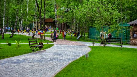 walking paths: BELGOROD, RUSSIA - June 13, 2016: New Belgorod zoo in the woods. Walking paths.