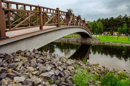 walking paths: BELGOROD, RUSSIA - June 13, 2016: New Belgorod zoo in the woods. Walking paths and a bridge across the pond. Editorial