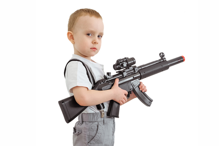 sullenly: Boy with toy machine gun isolated on a white background.