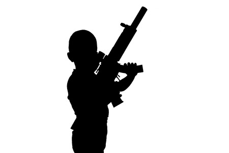sullenly: Black silhouette of a boy with a toy gun isolated on a white background. Monochrome image.