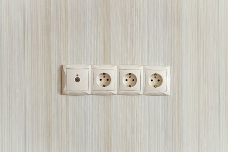 interlocked: Electric socket strip with TV output. Interlocked electrical outlet on the wall. Stock Photo