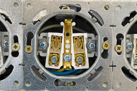 grounding: Open electric socket strip without front panel. Close-up. Work on installing interlocked electrical outlet. Stock Photo
