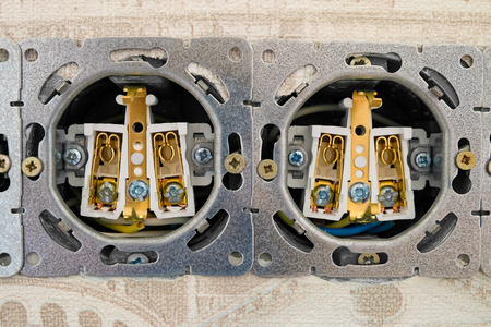 grounding: Open electric socket strip without front panel. Close-up. Work on installing interlocked electrical outlets.