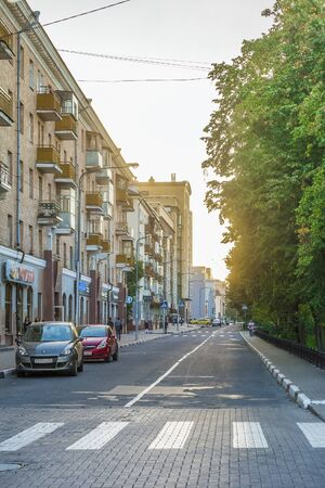 outumn: BELGOROD, RUSSIA - SEPTEMBER 10, 2016: Roadway Holy Trinity Boulevard in the center of Belgorod in the light of the low sun. Houses late Stalin era (mid 20th century) and modern buildings.