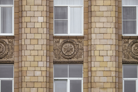 dictatorial: Fragment of facade building administrative government Belgorod region with USSR symbols. Typical architecture of the Stalin era. Stock Photo