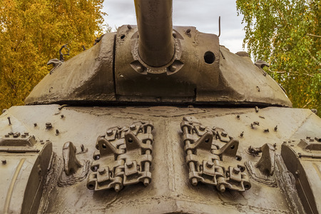 outumn: Fragment of the frontal armor old tank Stock Photo
