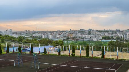 relievo: Evening view on the old center of city. by sports grounds of the Belgorod State Technological University. City skyline from the athletic fields of Belgorod State Technological University. Stock Photo