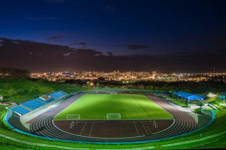 BELGOROD, RUSSIA - MAY 08, 2016: Stadium Belgorod State Technological University at night. Night cityscape. Editorial