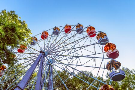 Classic Ferris wheel. Entertainment Park attraction with retro booths. Stock Photo