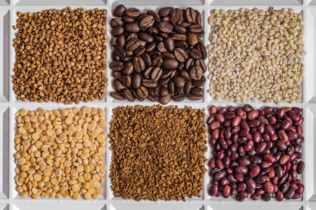 agrarian: Grocery set of food products: buckwheat, roasted coffee beans, pearl barley, dried peas, freeze-dried instant coffee, dried seeds of beans.