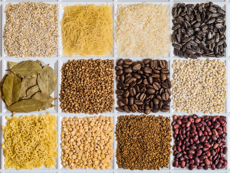 Grocery set of food products: barley grits, vermicelli, rice, sunflower seeds, bay leafs, buckwheat, roasted coffee beans, pearl barley, figured macaroni, dried peas, freeze-dried instant coffee, dried seeds of beans.