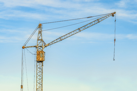 Old abandoned tower crane on a sky background Stock Photo