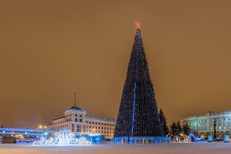 New Years Cathedral Square with christmas decorations and lights fir-tree in the center of Belgorod city. View of the Stock Photo