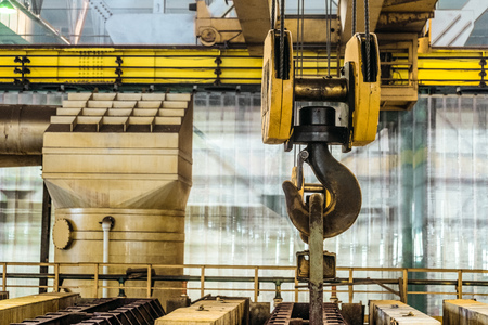 Steel hook of overhead crane over industrial equipment Banco de Imagens