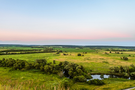 View of green forest-steppe plain. River Koren (Root) valley, typical landscape of Belgorod region, Russia. Evening time. Banco de Imagens