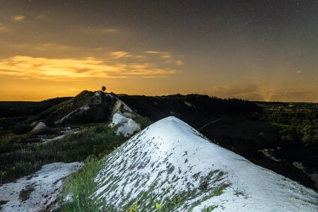 Night sky over the high chalk hills. Night natural landscape. Natural archaeological monument - Krapivenskoye ancient settlement, Belgorod region, Russia.