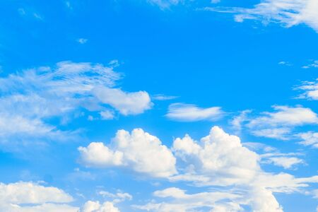 Bright white clouds on a blue sky. Universal template for background insertion. 스톡 콘텐츠