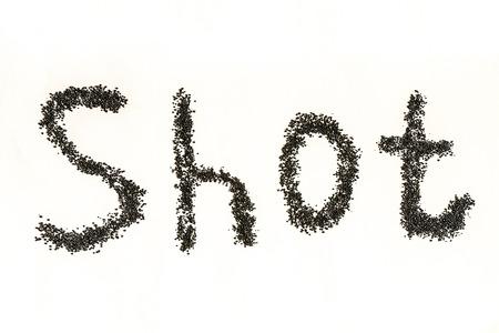 Steel shot for blasting machine. Inscription SHOT on a white surface. 版權商用圖片