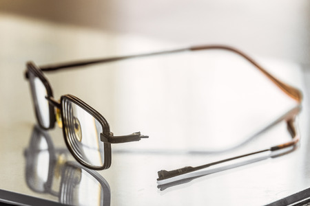 Eyeglasses with a broken handle. Limited depth of field. Imagens - 110010981
