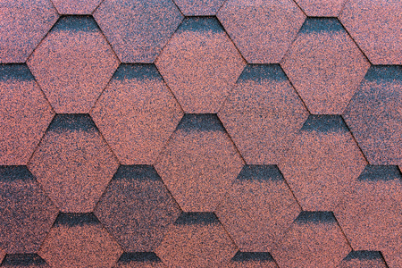Red roofing made of soft shingles. Close-up. Stock fotó