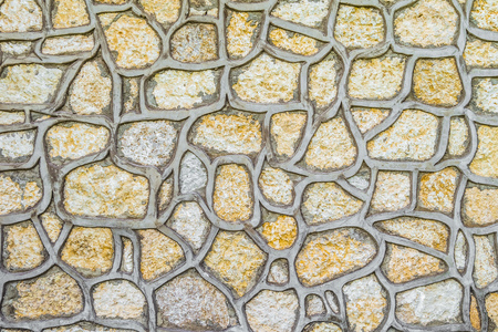 Natural stones for cladding construction. Texture facing surface of natural stone with gray seams.