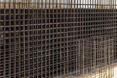 Reinforcing cage with joining longitudinal and transverse reinforcement. Shielded steel formwork for the construction of reinforced concrete monolithic structures. 版權商用圖片